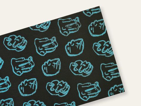 Postcard with repeated drawings of blue fists on a black background created by Loren Marple