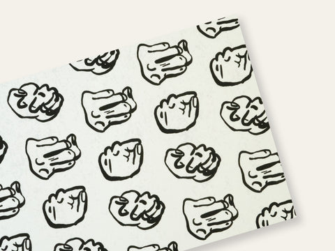 Postcard with repeated drawings of black fists on a white background created by Loren Marple