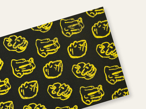 Front and back of a postcard with repeated drawings of yellow fists on a black background created by Loren Marple