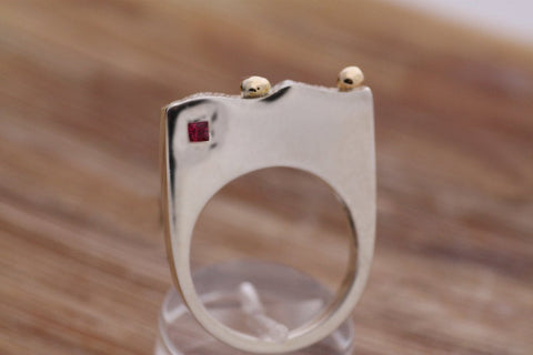 Sterling Silver ring with Gold k18 and a princess cut Ruby