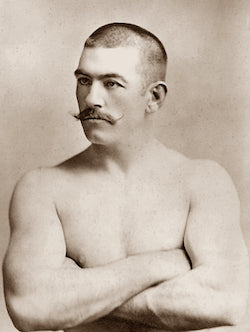 John Lawrence Sullivan (October 15, 1858 – February 2, 1918), also known as the Boston Strong Boy, in his prime. He was recognized as the first heavyweight champion of gloved boxing from February 7, 1882 to 1892, and is generally recognized as the last heavyweight champion of bare-knuckle boxing under the London Prize Ring rules