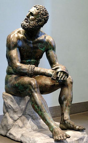 """So-called """"Thermae boxer"""": athlete resting after a boxing match. Bronze, Greek artwork of the Hellenistic era, 3rd-2nd centuries BC. From the Thermae of Constantine."""
