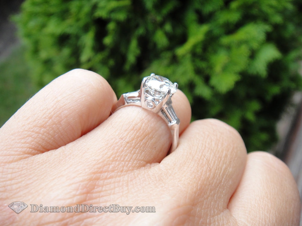 Platinum Solitaire With Side Baguettes Engagement Rings