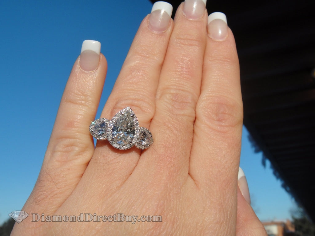 Three Stone Pear Halo Ring Engagement Rings