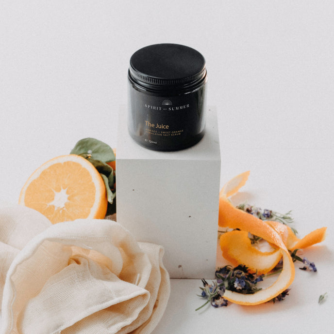 The Juice Salt Scrub - Nourishing borage seed oil, sweet orange bergamot and rosemary essential oil scent body scrub that leaves skin exfoliated and glowing. Made with dead sea salt, Himalayan pink salt, cocoa butter, shea butter, coconut oil, sweet almond oil, jojoba oil.