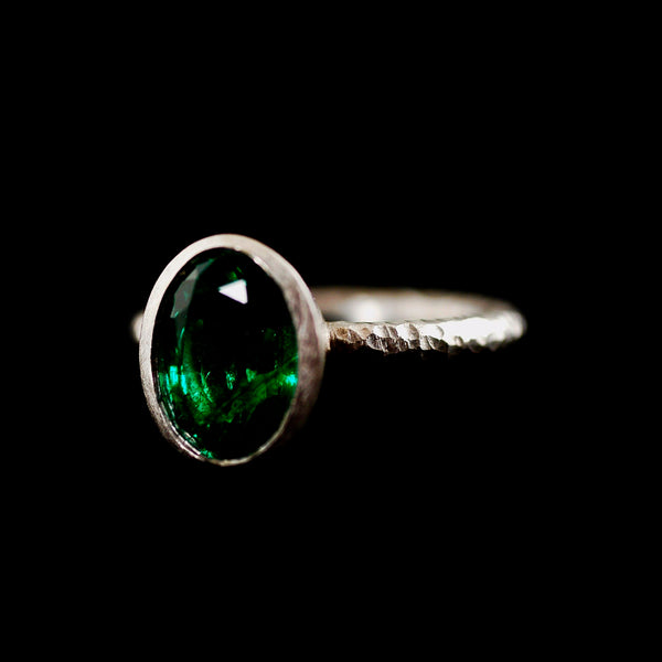 Pinched Platinum Oval Emerald Ring