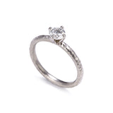 Pinched Platinum Claw Set Diamond Ring