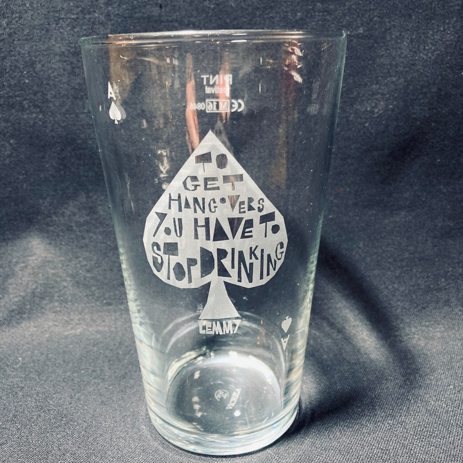 A set of 4 Vinyl Revolution beer glasses featuring a quote from Lemmy