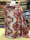 An elegant white kashmiri shawl with multi colour floral embroidery all over.
