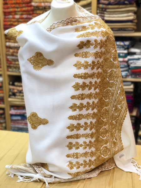 Beautiful white shawl with elegant gold embroidery and garnished with diamantes.