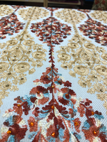 Elegant white shawl has combination of gold and multicolour embroidery and garnished with diamantes.