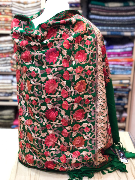 A green kashmiri shawl with multi colour floral embroidery all over.