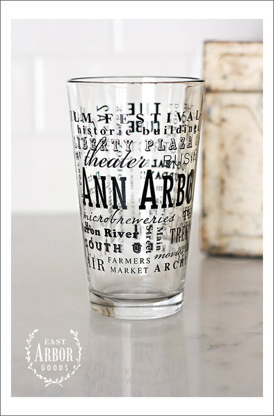 Pint Glass featuring Ann Arbor, Michigan with highlights from the town in black screen print