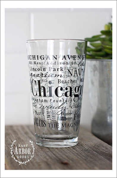 Pint Glass featuring Chicago, Illinois with highlights from the town in black screen print.