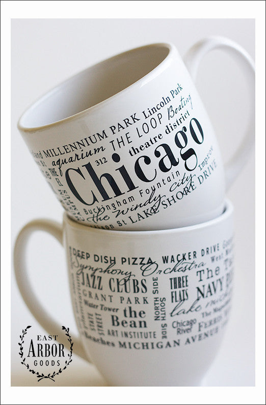 White ceramic coffee mug featuring Chicago, Illinois with places and activities featured in different fonts in black screen print.
