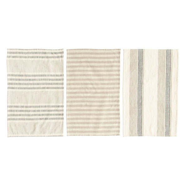 Three cream cotton kitchen towels laid out to show the different woven stripped patterns. The towels are on a white background.