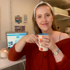 Image of me at my desk with a cup of tea