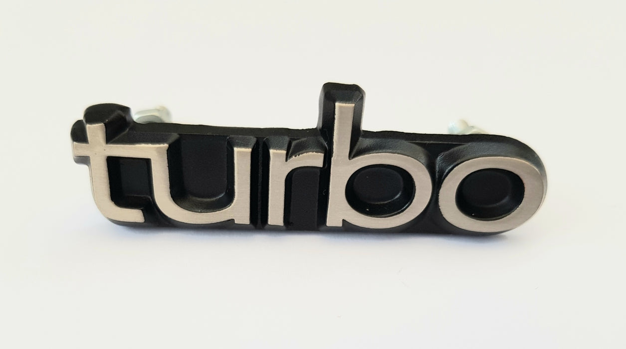 C900 or 9000 Turbo grill badge 65mm x 20mm x 3mm supplied with fittings