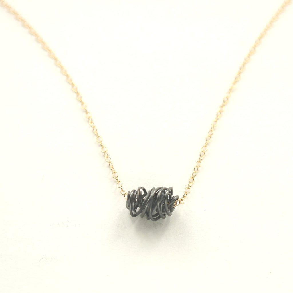 SIMPLI . Mixed Metal Tiny Necklace (black on gold)