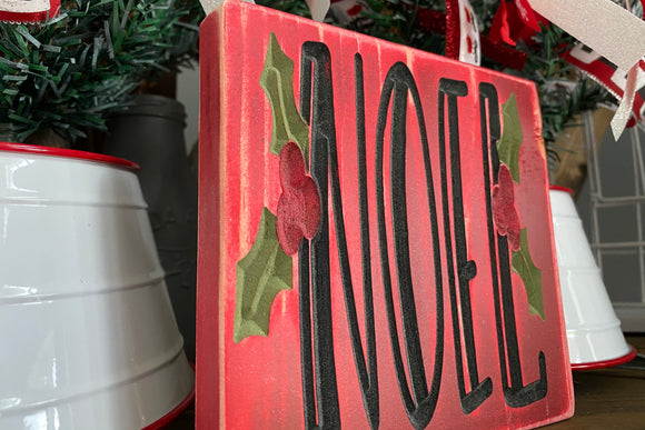 'Noel' engraved sign