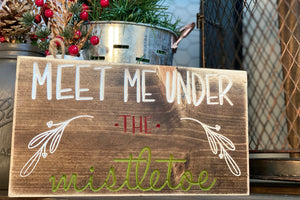 'Meet Me Under The Mistletoe' engraved sign