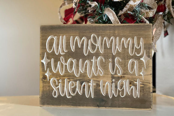 'all mommy wants is a silent night' engraved sign