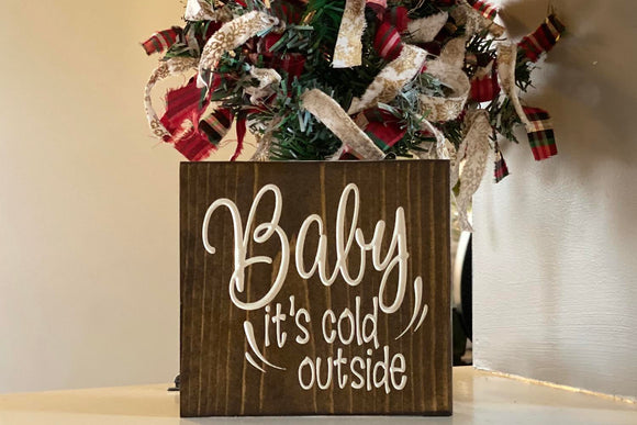 'Baby it's cold outside' engraved sign