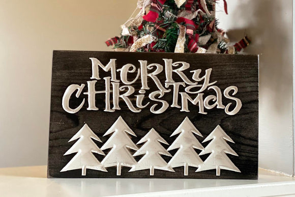 'Merry Christmas' engraved sign with trees