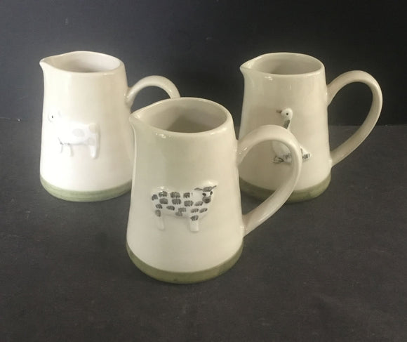 Animal design ceramic cream jugs