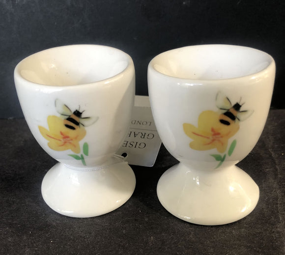 Two bee themed egg cups