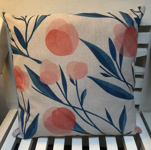 Coral fruit and dark teal foliage pattern cushion