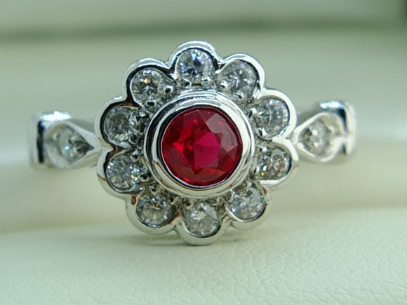 18 CT White Gold Ruby and diamonds ring