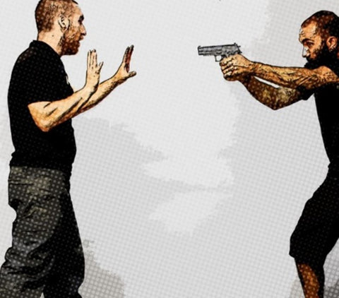 man pointing a gun at another