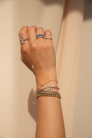 hand wearing several rings and bracelets