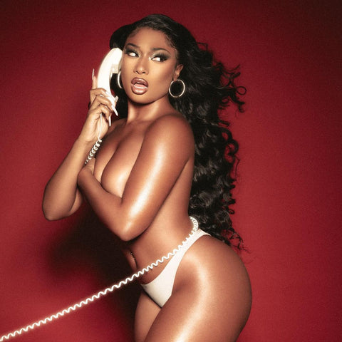 Megan Thee Stallion posing with old telephone