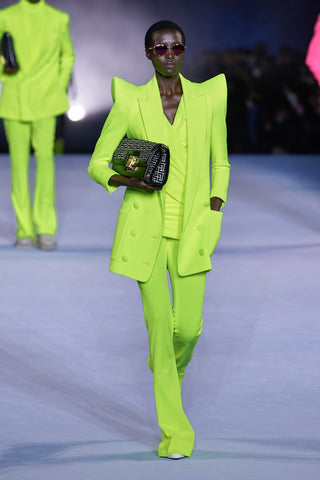 green suit with shoulder pads