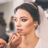 image of a bride getting her makeup done