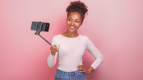 image of a woman taking a selfie in a white shirt for a Color analysis