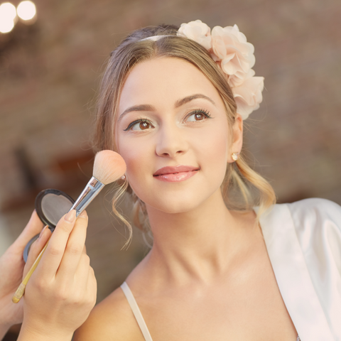image of a woman getting special occasion makeup done