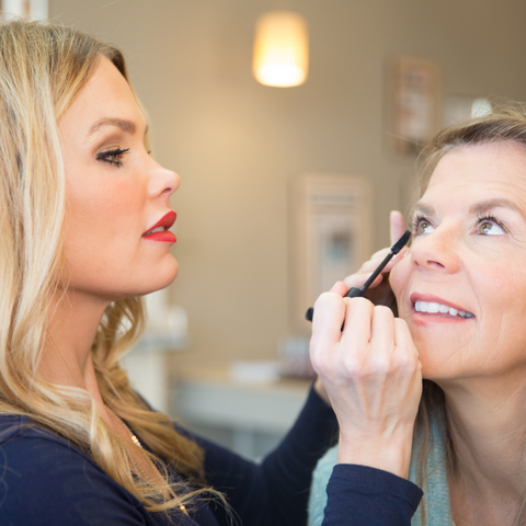 image of a woman getting a makeup lesson