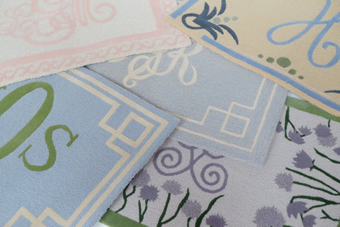 Design Your Own Rug, Rugs layered in blue, pinks and purples. Monogrammed rugs