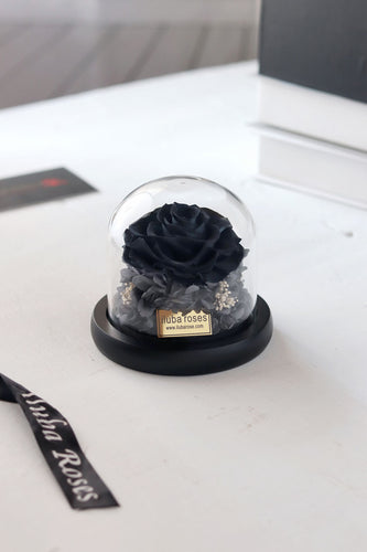 black rose flower in glass vase at Iluba Roses shop in Riyadh