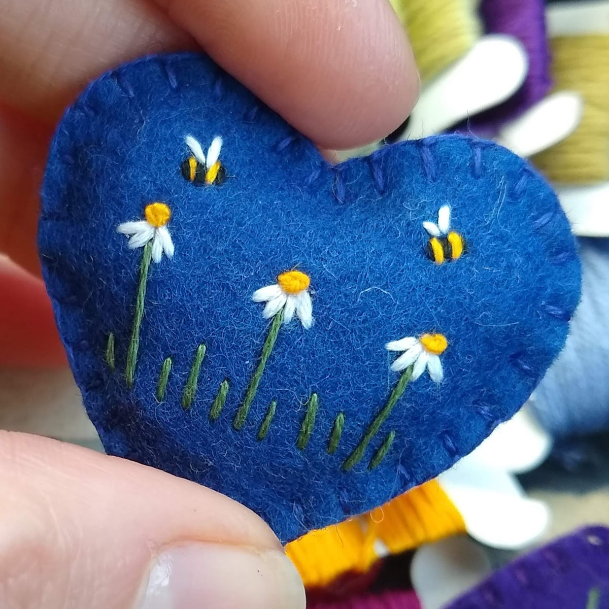 Embroidered pocket hug