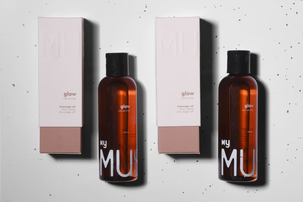 Two 100ml Glow Relaxing Bottles along with their packaging lying flat on the floor side by side