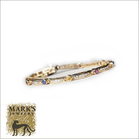 02527 14K Yellow Gold Bracelet with Diamonds, Rubies, and Blue and Yellow Sapphires