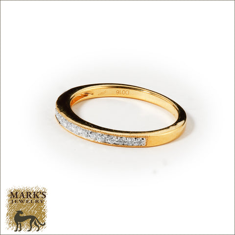 * 06591 18K Yellow Gold 0.16dwt Channel Set Diamond Band