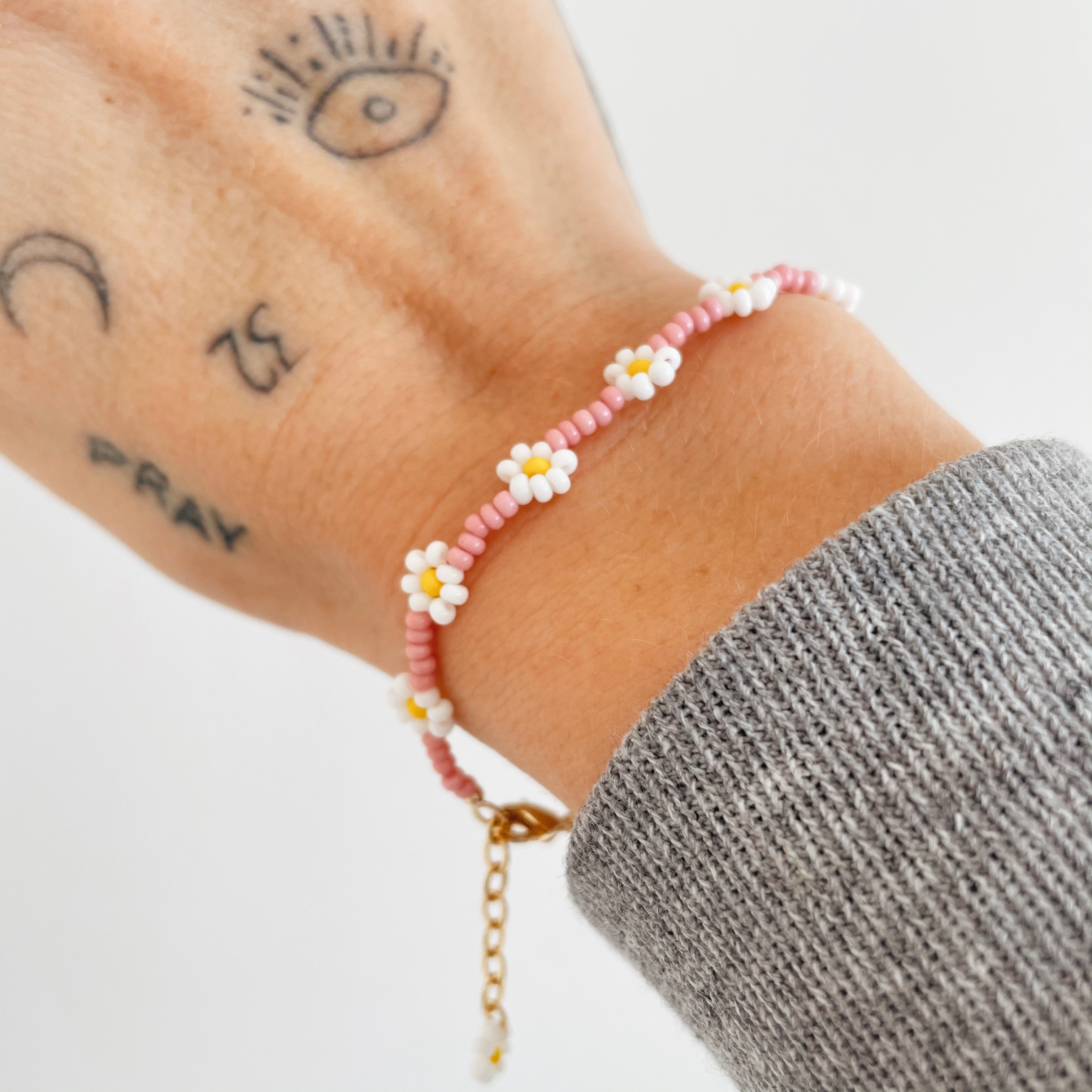 "For the 90's girl that's grown up! The Classic Daisy is a staple but elevated! Made with colorful beads and 18K gold plated details.  This set looks great all year round, whether it's with a chunky knit or at the beach. It's just perfect!  The bracelet is adjustable between 6"" and 7""  The necklace is adjustable between 14"" and 16""  The ring is made with stretchy material and is one size fits most."