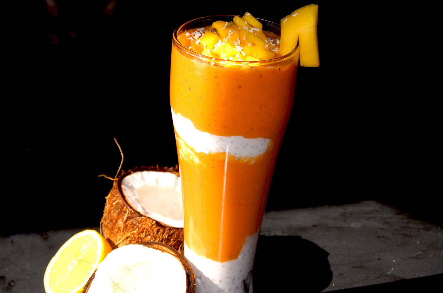 Mango and goji berry smoothie parfait with chia seeds and coconut