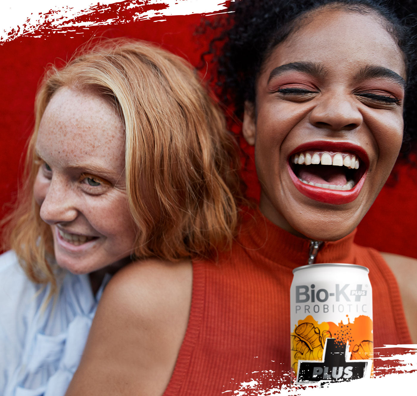 Photo of two women smiling and enjoying their iced tea
