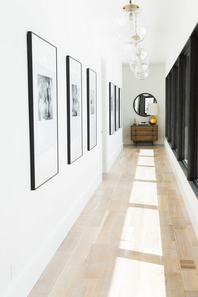 Oversized frames hung on a white wall